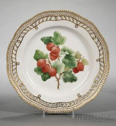 "Royal Copenhagen ""Flora Danica"" Luncheon Plates, 20th century, with reticulated rim, each painted with a highly realistic fruit or berry specimen, gilt crenellated rim."
