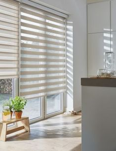 This shows zebra blinds, on the left window they are lined up for privacy, on the right windows they are lined up for partial privacy. Curtains Vs Blinds, Patio Door Blinds, Indoor Shutters, Zebra Blinds, Blinds For Windows, Patio Doors, Persiana Double Vision, Room Color Schemes, Condo Living