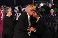 Ahmed Kathrada kissing Zanele Mbeki with Barbara Hogen and Thabo Mbeki in the background at Madiba's State Funeral on December 15 2013 in Qunu South...