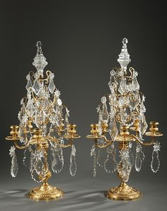 A pair of gilt bronze and crystal candelabra with five S-shaped lights decorated with several levels of slice-cut drops, rosette and star patterns issuing from a ormolu fluted. Chandeliers, Antique Chandelier, Antique Lighting, Chandelier Lighting, Lustre Antique, Style Louis Xv, Buffet Lamps, Murano, Beautiful Lights