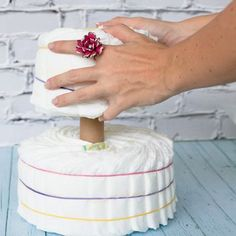 The Diaper Cake is the Mother of all Cakes at a baby shower. Cute little piles of diapers all bundled and covered in ribbons – to look like a multi-tiered cake. It's irresistible! But how does a person make a diaper cake without spending hours rolling and tying up all those little diapers? The method shown below will have you on your way to diaper cake greatness in minutes. And [...]