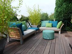 Unifying color scheme of aqua, lime and flax colored cushions for deck furniture. Sittingimage Lounge www.sittingimage.com