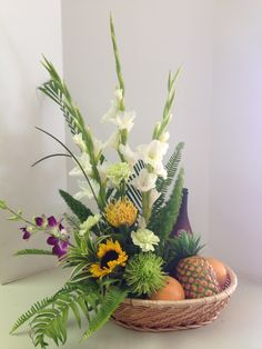 Nothing says tropical more like this fresh fruit and gorgeous flower arrangement.  $130.00