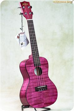 Deb: I went to the Strum Shop (Roseville, CA) today for my weekly Ukulele lesson, and ended up buying this   A-DORABLE Exotic Mahogany Magenta Soprano Kala Ukulele. This is #3 (giggle) $94.99 + tax