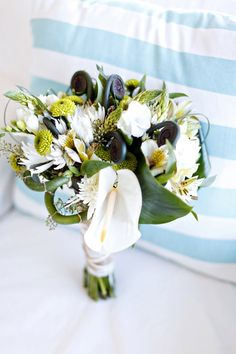 www.fioreofpensacola.com // www.avantimages.com   Fern curls, Freesia, Anthurium, different types of mums & Peruvian Lilies were combined to create this modern bouquet