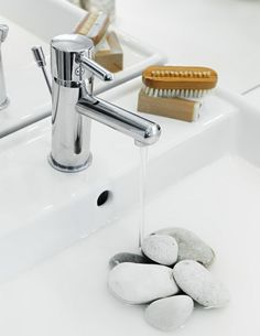 Earth, health and wellness bathroom. Feng Shui: cover hole/drain in sink w/ rocks to keep chi (energy) from going down the drain (stop the tub drain, & keep toilet lid closed too)