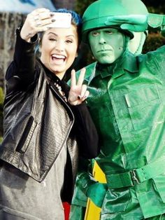 demi lovato taking a selfie with a soldier at disneyland