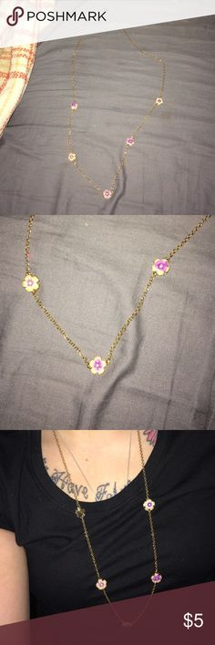 Long floral necklace and earring set Long chained, flower necklace. Purple and white flowers with a long gold chain with matching stud earrings. Earrings never worn. Avon Jewelry Necklaces