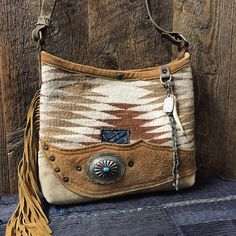 Navajo mini bucket with side fringe and sterling/turquoise concho