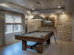 Just because you have a pool table doesn't mean your place has to feel like a pub. This rustic industrial game room is unexpected. A reclaimed tin pendant fixture from Curry