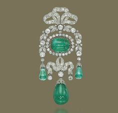 A BELLE EPOQUE EMERALD AND DIAMOND BROOCH, BY CARTIER.