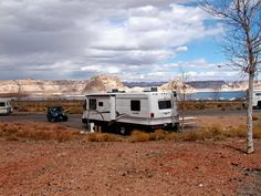 Here are some secrets of how to live on less by full-time RVing. Many retirees live well on limited incomes by living in an RV rather than a house. They have found many ways to cut costs and live on less. Read here to find out how they do it. Living On The Road, Rv Living, Do It Yourself Camper, Live On Less, Survival, Go Camping, Camping Ideas, Camping Recipes, Camping Stuff