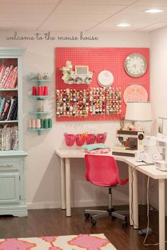 a beautiful colorful, coral and aqua basement sewing room with giant painted peg board for diy thread organization. This room is full of DIY Craft Storage and plenty of space of crafting. I dream of a craft space like this!