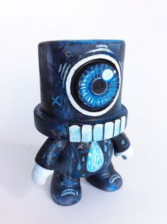 Custom Spray Qee Toy by Chris Brett, via Behance