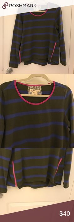 Most adorable striped long sleeve shirt ever This is SUCH a cute long sleeve shirt. It's dark green with dark blue stripes and adorable pink detailing around the neck and on the bottom as 2 zippers. I loved this shirt so much. One small stain, pictured in last photo. Tops Tees - Long Sleeve