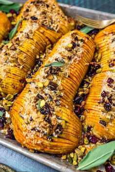 Honey-Glazed Hasselback Butternut Squash With Parmesan Breadcrumbs This fall and winter dish has it all thin crisp slices tender flesh a sweet and garlicky glaze and crunchy pistachio and parmesan breadcrumb topping Side Dish Recipes, Vegetable Recipes, Vegetarian Recipes, Cooking Recipes, Winter Dishes, Easy Casserole Recipes, Vegetable Dishes, Thanksgiving Recipes, Food Dishes