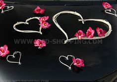 Exclusive wedding decoration for wedding car.  Very elegant composition.   hard to buy something so beautiful!