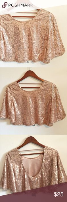 {Cecico} Rose Gold Sequined Crop Top NWT Pretty Cecico Rose Gold sequined Flowy Crop Top NWT in great condition with a low dipped backless back. Size Small. 100% Polyester. Hand wash only. Open to offers :) Cecico Tops Crop Tops