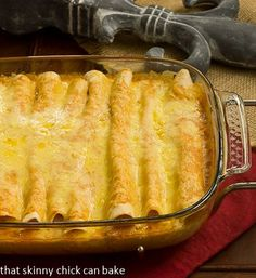 Cheesy Chicken Enchiladas | Pure comfort food and one of my most raved about recipes!  From thatskinnychickcanbake.com @lizzydo