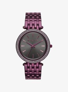 A little glam, a little girl next door—our Darci watch delivers chic attitude every time. A pavé-embellished bezel and plum-hued setting render this timepiece colorfully cool. Team it with silver or gold-tone pieces for a pretty pop. $250