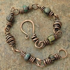 Tiny trade bead replicas are wire wrapped with copper wire and handmade copper beads to form this rustic bracelet. The clasp is heavy gauge copper wire.  The copper wire was polished with Renaissance Wax to preserve the finish.