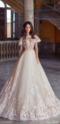 Lorenzo Rossi 2018 bridal dress with cap sleeves - Tulle skirt adorned with three-dimensional floral appliqués and beautifully embellished top combined with cap sleeves give this gown an aristocratic touch.