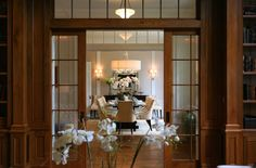 Beautiful dining room design with glass pocket doors, transom windows, tufted ivory dining chairs with nailhead trim and crystal chandelier. French Pocket Doors, Glass Pocket Doors, Glass French Doors, Glass Doors, Traditional Home Exteriors, Double Doors Interior, Interior Doors, Transom Windows, Beautiful Dining Rooms