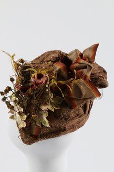 A brown figured silk bonnet, circa 1890.