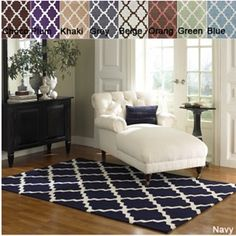 This rug is perfection.  Planning a navy blue and white guest room with splashes of bright yellow.  Loving moroccan/trellis/quatrefoil right now.