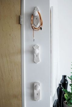 Old doorknobs as hangers - I would have them in a horizontal line for coats