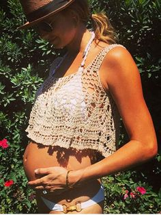 Stacey Kiebler looked beachy and relaxed in aviator shades, a fedora, and a white bikini and crocheted crop top combo that showed off her burgeoning belly.