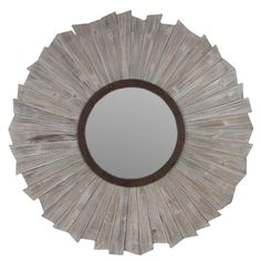 Update your home decor in a more rustic style with this wooden mirror. Circling the round glass is a frame made from different sized wood, letting the mirror give any room it's own, unique look.