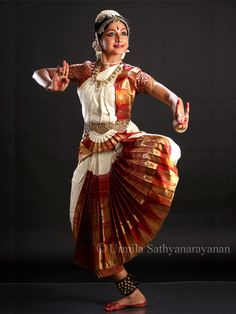 Arts: This picture is a picture of an Indian dancer. The type of dance that she is performing is called Bharatanatyam. This style of dance is performed all over southern India.  India is so big in dancing and performing. There is a huge city just like how we have Hollywood in America, they have a city called Bollywood where all the celebrities and producers live. Many movies that are in India, get produced in Bollywood.