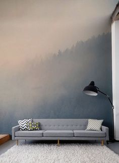 Gaze across the treetops with the beautifully hazy forest wall mural. Soft pastels colour make this a soothing wallpaper for living room spaces.