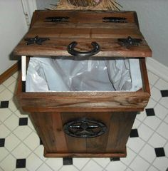 Rustic trash can...I could do without the star and horseshoes but I like the wood