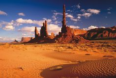 Red Rock Towers With Sand Patterns At Monument Valley Tribal Park Arizona And Utah Border, Photo by: Ron and Patty Thomas Photography/Getty Images - via mymodernmet