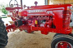 Farmall H, my fave of the Farmalls.This looks like the one we had.  We had a farmhand who tried to go 30 mph on this tractor- the man was nuts, but I think he was a former convict- you meet all kinds on a farm!