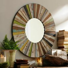 colorful mirror-could maybe make with plain round mirror and painted strips of wood?