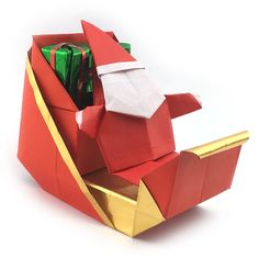 Origami Santa with his sleigh