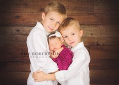 brothers with baby sister newborn photo My boys aren't old enough for a photo like this but super cute!