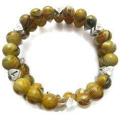 New Yellow Harlequin Breastfeeding Bracelet https://www.etsy.com/listing/227390174/handmade-yellow-harlequin-glass-bead