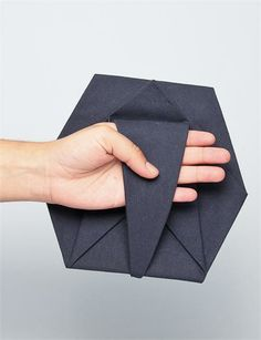 Geometric Fashion - origami clutch bag with folded hexagonal structure // Cosmic Wonder