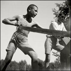 Herbert List 1938 Romania. Dolj County. Physical activities of the group include a significant amount of labour. Baracks and an assembly hall in a surrounding village are built as community work