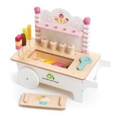 Children's Pretend Play Pink and White Wooden Ice Cream Cart Toy With Accessories Everyone loves Ice cream! Come to the Ice Cream Cart where the popsicles, lollies and ice cream cones are ready to be served! There is a clever ice cream scoop that magicall Ice Cream Cart, Love Ice Cream, Ice Cream Scoop, Toddler Gifts, Toddler Bed, Smoothie Mixer, Living Puppets, Bebidas Do Starbucks, Colorful Ice Cream