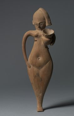 Statuette of a Serving Girl, c. 1323-1186 BC Egypt, New Kingdom, late Dynasty 18 (1540-1296 BC) to Dynasty 19 (1295-1186 BC) terracotta, originally painted, Overall - h:38.40 w:9.20 cm (h:15 1/16 w:3 9/16 inches). Cleveland Museum of Art