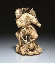 JAPANESE IVORY OKIMONO OF A HUNTER
