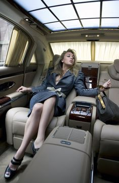 Kaley Cuoco star of The Big Bang Theory poses inside of a Maybach for Watch! Magazine.