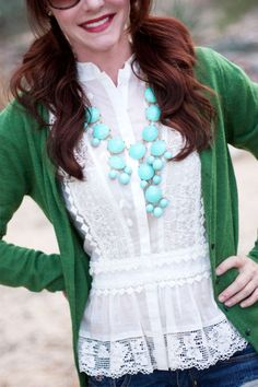 Green cardigan, white lace blouse and turquoise jewelry