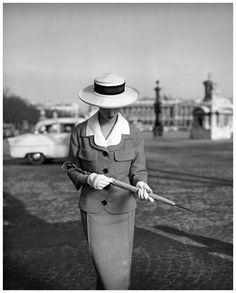 Model wearing a suit by Jean Patou for Elle, March 1957. Photo by Georges Dambier.