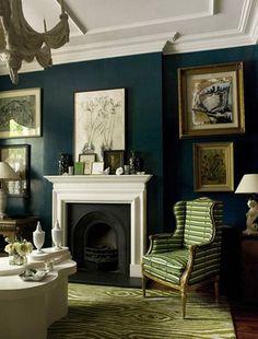 blue-green walls. green armchair. white ceiling.